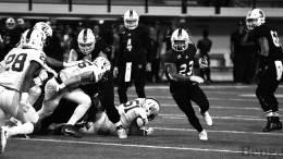 ISU #23 running with football during game.