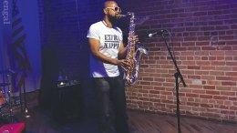 Jazz Fest band member playing saxophone