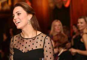 Kate Middleton shows more than a hint of baby bump at charity event.