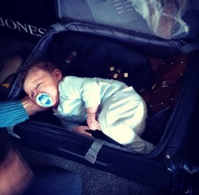 Megan Gale's son River hiding in a suitcase
