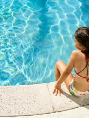 Swimming pool girl on side