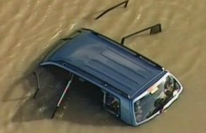 Homicide squad investigating a car plunging into a lake leaving three children dead.