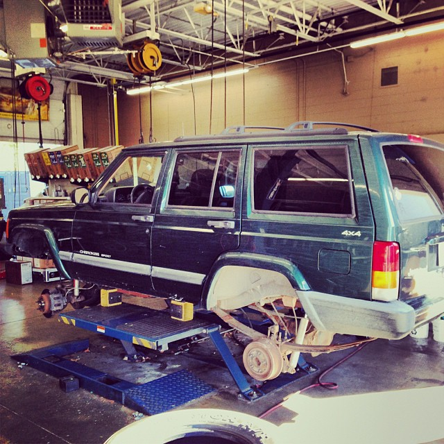Getting new shoes on the Jeep...