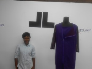 Jami Lake Standing beside her logo and one of her 2016 Designs