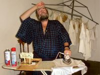 James White, the artist, in performance, slaving away at the iron