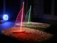 Desert Breeze, 8' x8' x 4', sand fingerprints, luminous tubes powered by radio waves (no wires), sheet polycarbonate, wood