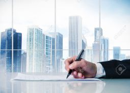 30180260-Man-signing-a-business-contract-in-a-desk-Stock-Photo-corporate