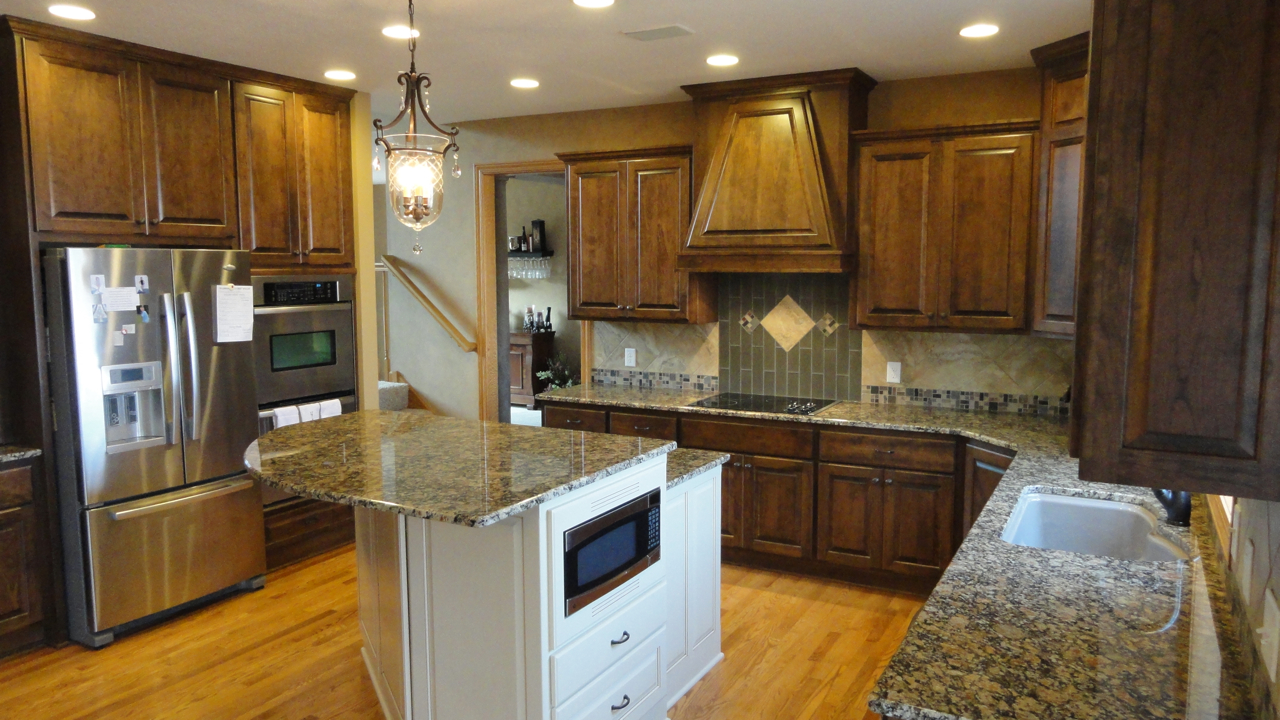 cherry stained kitchen cabinets poplar in the kitchen staining kitchen cabinets It
