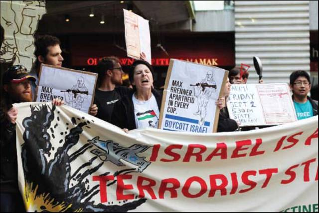 Protesters boycott a branch of Israeli chocolatier Max Brenner in Melbourne, Australia, in 2012. BDS mobs assaulted local police, leading to arrests of protesters and a repudiation by Australian Jewish leaders.