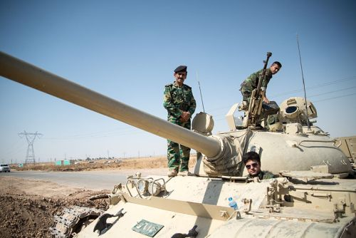 Kurdish peshmerga on a T-55 tank outside of Kirkurk Iraq (Boris Niehaus, WikiCommons)