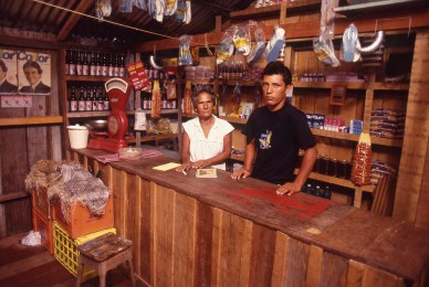 Son and Mother in their Store