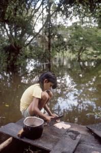 Girl Preparing Fish for Lunch, Muritinga