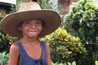 Boy With His Father's Hat, Fetching Water