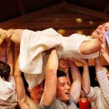 Bride crowd surfing.