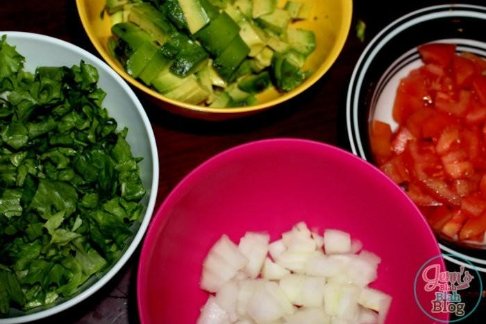 lettuce, onions, tomatos, and avacado on a table Want Easy Dinners Ideas? Try This Easy Chicken Taco Salad Recipe!