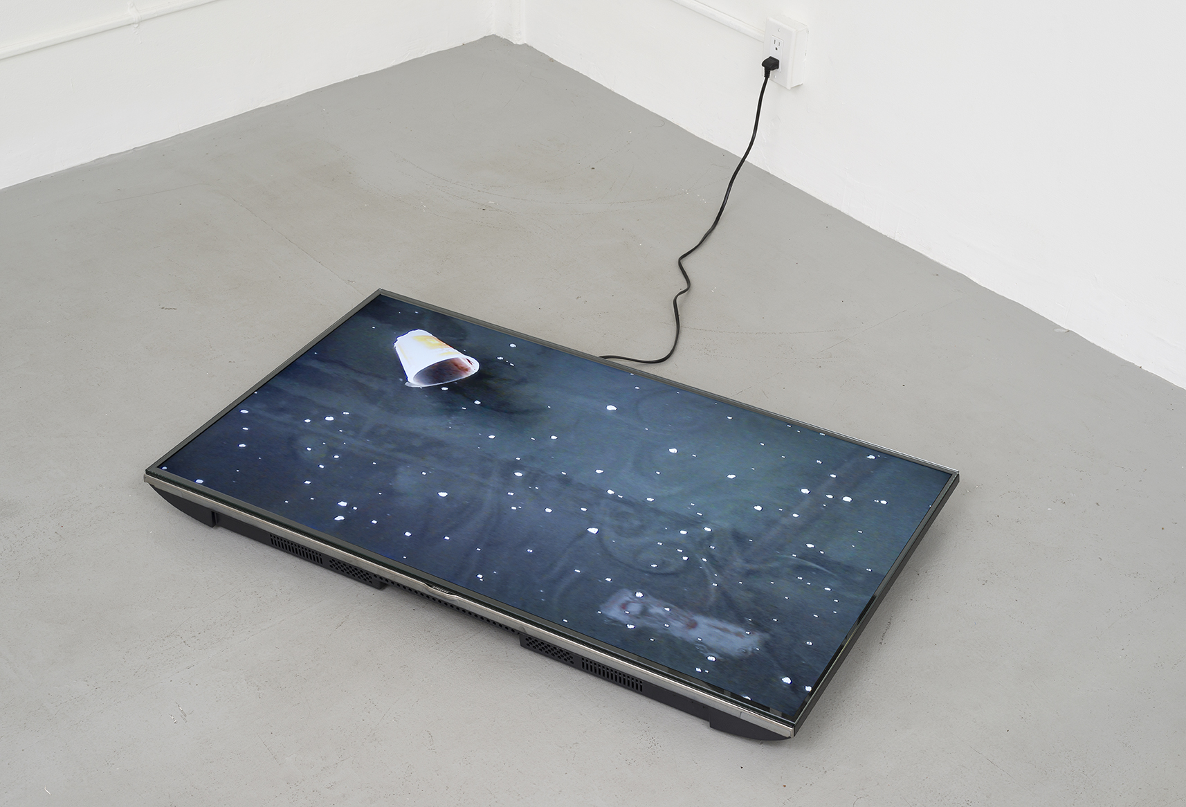 - Duh Angel Puddle, 2015, HD video, Samsung monitor, glass top. loop, 24 1/2 x 42 inches (monitor)