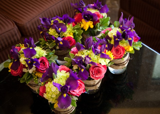 Arrangements of irises, roses, hydrangea & freesia