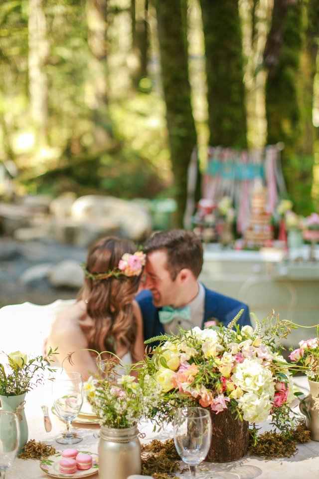 Treehouse Point Bridal Shoot Bride & Groom at Table || Flowers by Jen's Blossoms || Photo by Lloyd Photography