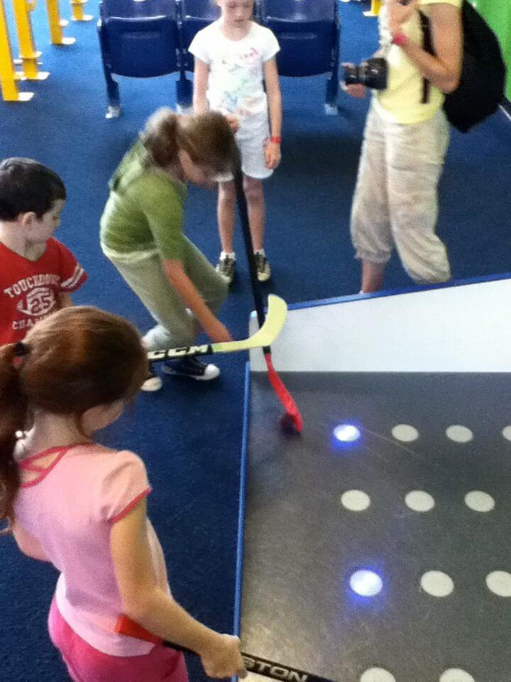 Practice controlling the stick in this hockey game at the Carnegie Science Center.