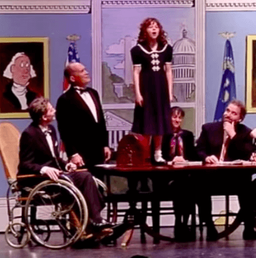 "My 10yo performing as ""Annie"" and me performing as FDR. The wheelchair suggests how I well I did during the dance audition, but I do a pretty good job leading my cabinet in ""Tomorrow."""