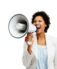 Successful business woman with a megaphone on white