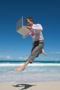 iStock_Joyous-computer-man-on-beach-XSmall.jpg