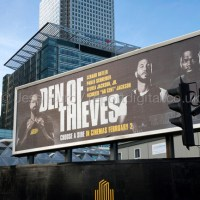 Den of Thieves, American heist film advert written, directed and produced by Christian Gudegast juxtaposed with Canary Wharf, Bank of America, London Docklands.