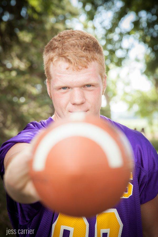 Senior Boy With A Football - Eyes In Focus