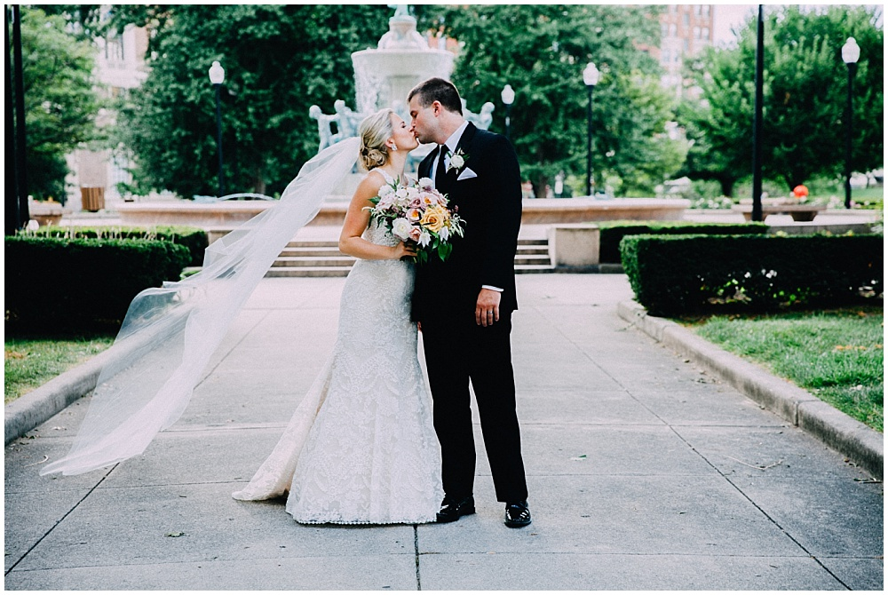 Bride and Groom with organic wedding blooms | Downtown Indianapolis Wedding by Caroline Grace Photography & Jessica Dum Wedding Coordination