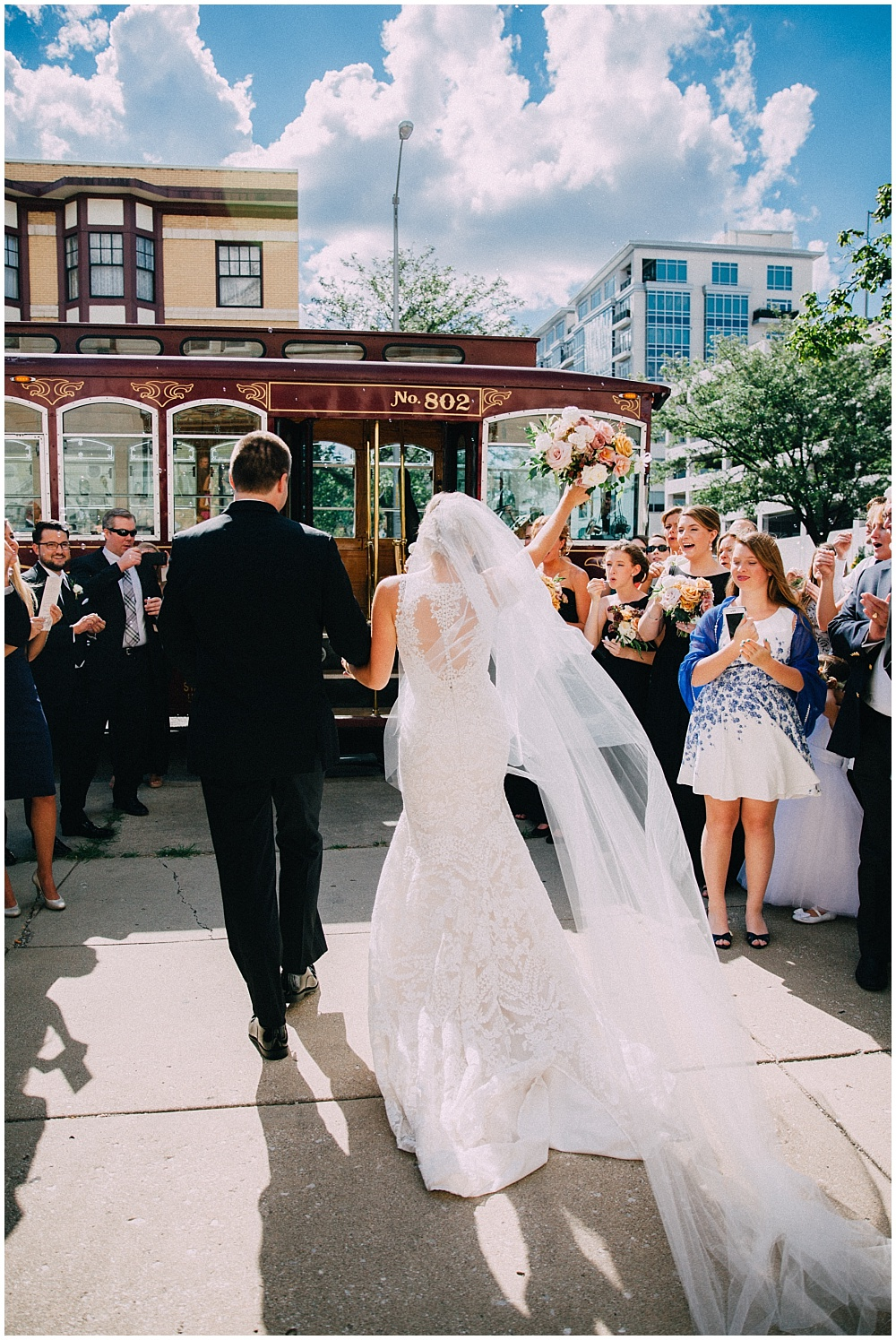 Bride and Groom ceremony exit, and back of lace wedding dress | Downtown Indianapolis Wedding by Caroline Grace Photography & Jessica Dum Wedding Coordination