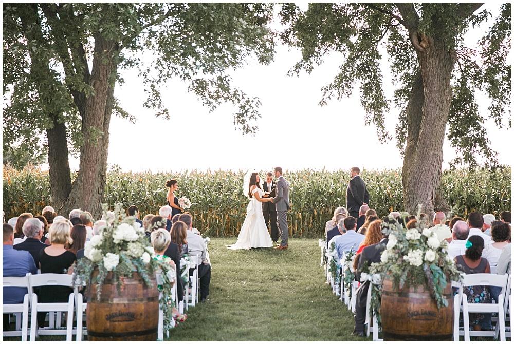 Wedding ceremony with cornfield backdrop | Family Farm wedding by SB Childs Photography & Jessica Dum Wedding Coordination