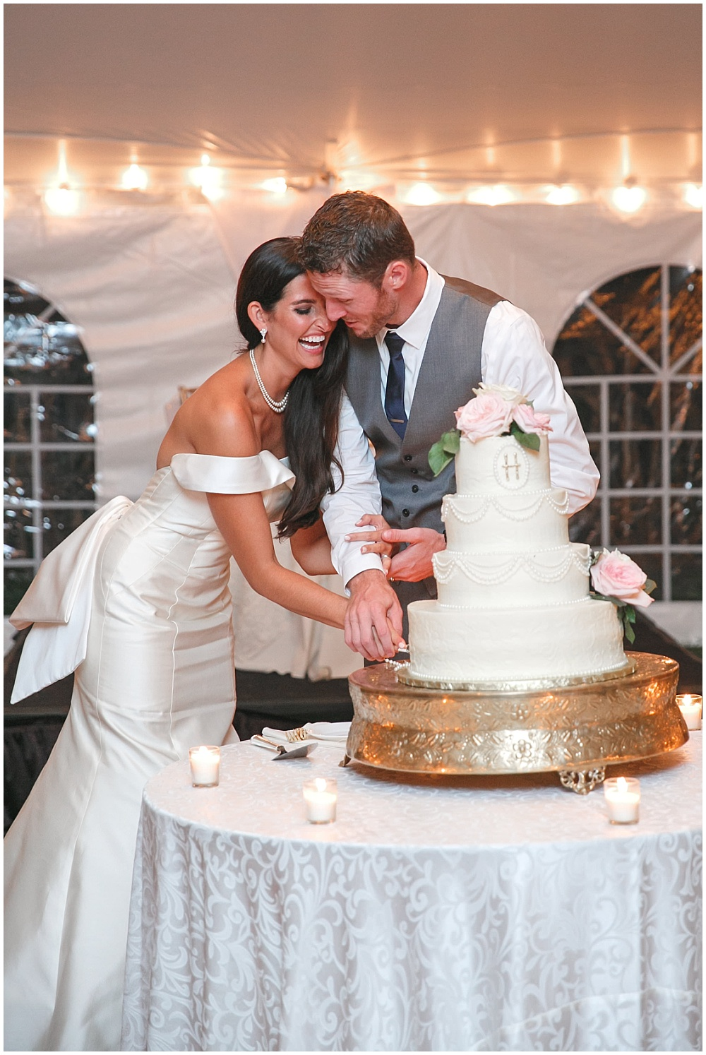 Bride and Groom cake cutting | Family Farm wedding by SB Childs Photography & Jessica Dum Wedding Coordination