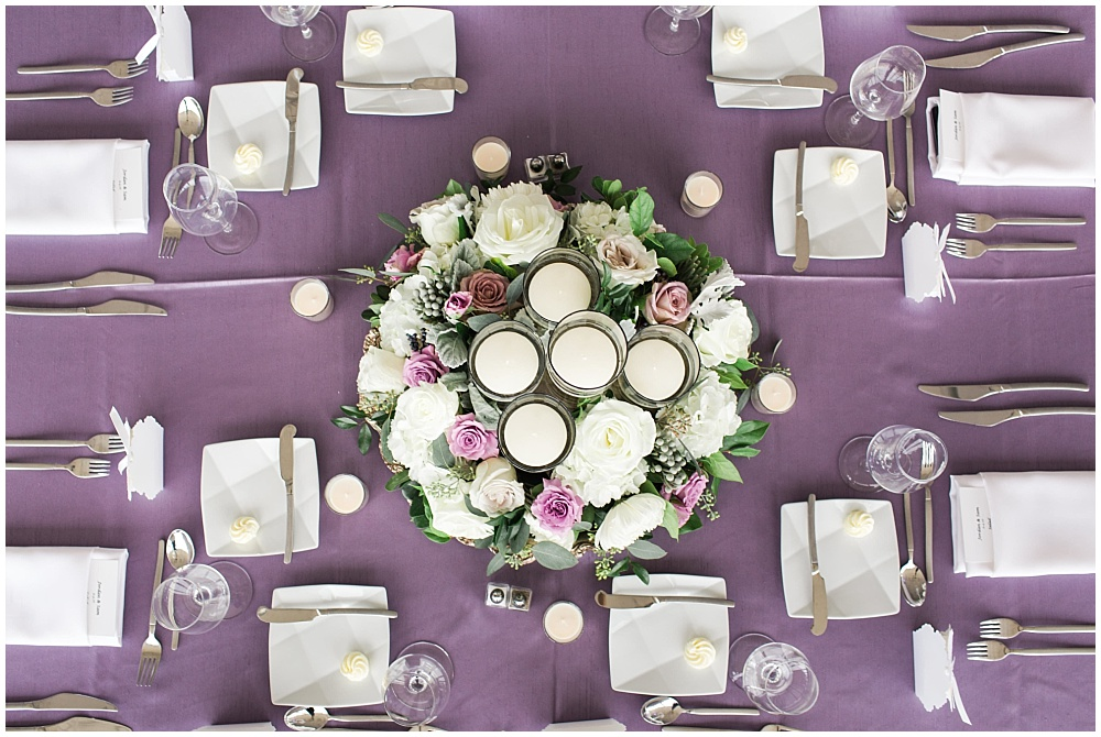 Purple table linens with white floral centerpieces and candles | D'Amore Wedding by Ivan & Louise Images & Jessica Dum Wedding Coordination