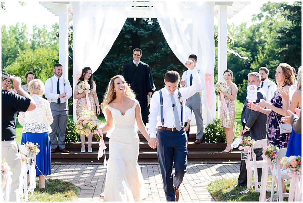 Bride and Groom ceremony exit | Mustard Seed Gardens Wedding by Sara Ackermann Photography & Jessica Dum Wedding Coordination
