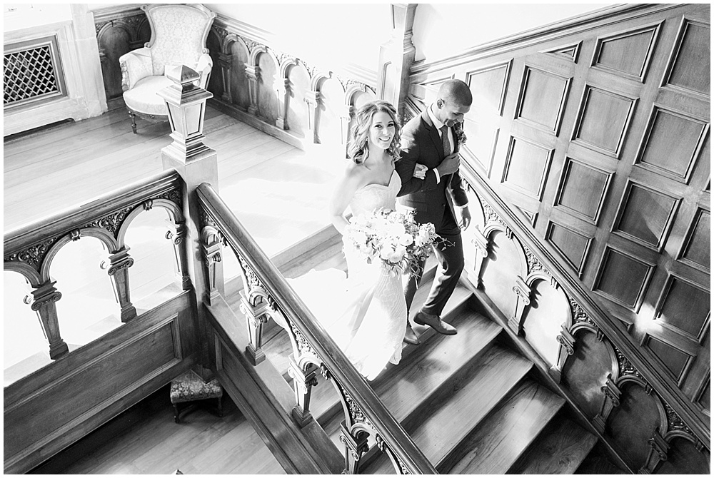 Bride + groom staircase entrance | Navy and Gold Wedding at Laurel Hall with Ivan & Louise Photography + Jessica Dum Wedding Coordination