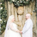 Bride and groom in front of ceremony tree with draped garland, navy and pink southern wedding | Ivan & Louise Images and Jessica Dum Wedding Coordination