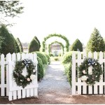 Charming southern reception entrance with floral wreaths, navy and pink southern wedding | Ivan & Louise Images and Jessica Dum Wedding Coordination