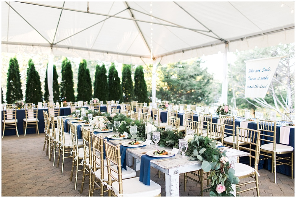 Intimate navy and pink wedding reception with farmhouse tables and draped greenery, navy and pink southern wedding | Ivan & Louise Images and Jessica Dum Wedding Coordination
