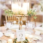 ivory and gold table numbers; gold centerpieces with candles; gold mercury votives; Scottish Rite Cathedral Indianapolis Wedding; neutral floral and greenery wedding| Ivan & Louise Images and Jessica Dum Wedding Coordination