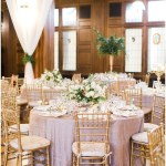 gold crush linens; gold chiavari chairs; white draped fabric tied back with greenery sprigs; Scottish Rite Cathedral Indianapolis Wedding; neutral floral and greenery wedding| Ivan & Louise Images and Jessica Dum Wedding Coordination