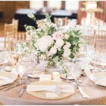 gold crush linens; glass vanilla lace BBJ Linen chargers; individual bud vases with white flowers at each place setting; blush and ivory florals; Scottish Rite Cathedral Indianapolis Wedding; neutral floral and greenery wedding| Ivan & Louise Images and Jessica Dum Wedding Coordination