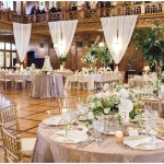 gold crush linens; ivory floral centerpieces; gold and ivory tablescape; fabric draped and tied back with greenery; ; Scottish Rite Cathedral Indianapolis Wedding; neutral floral and greenery wedding| Ivan & Louise Images and Jessica Dum Wedding Coordination