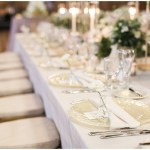 glass vanilla lace BBJ Linen chargers; ivory tablescape; gold chiavari chairs; individual bud vases with white flowers; Scottish Rite Cathedral Indianapolis Wedding; neutral floral and greenery wedding| Ivan & Louise Images and Jessica Dum Wedding Coordination