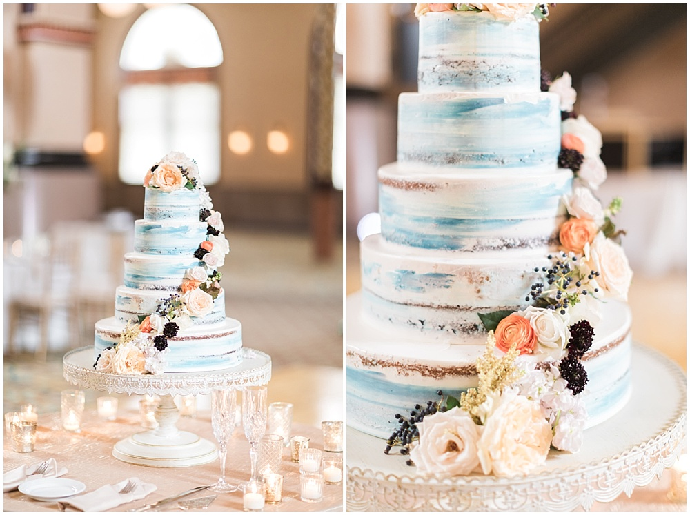 blue naked cake with subtle flowers; antique white pedestal cake stand; Mexican inspired gold & floral wedding; Crowne Plaza Indianapolis Downtown Union Station; neutral floral and greenery wedding|Cory + Jackie and Jessica Dum Wedding Coordination