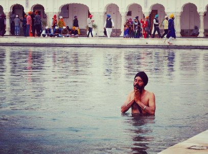 Sikh bathing at the Golden Temple Amritsar