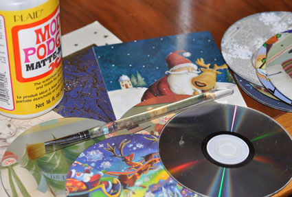 Make ornaments from old CDs with holiday cards and Mod Podge.