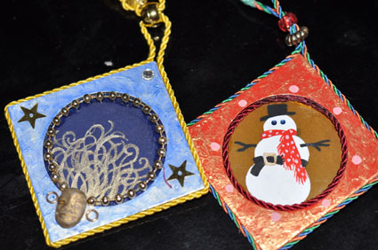 Coin envelope ornaments designed and handpainted by Graphic Artist Jann Bell.