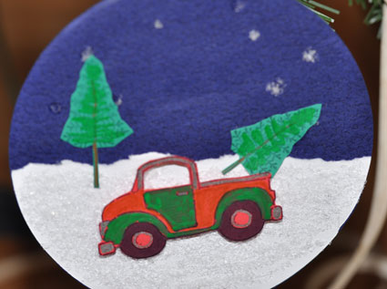 Create ornaments from upcycled CDs using scrapbook paper, rubber stamps and embellishments.