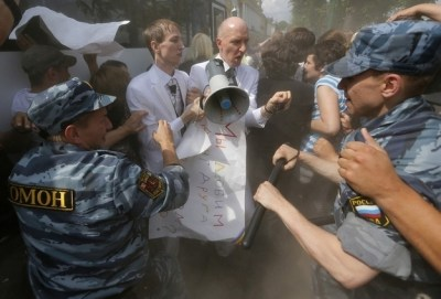 Gay Russian protestors being assaulted.