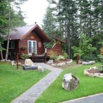 Cedar House Restaurant and Chalets features lovely landscaping and cool chalets.